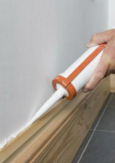 Baseboard styles and value to your home with decorative baseboard molding. 30 ideas style and let the professionals at show you how with step-by-step instructions. Caulk Baseboards, Painting Baseboards, Baseboard Trim, Drywall, How To Install Baseboards, Home Improvement Projects, Home Projects, Fixer Upper, Home Renovation