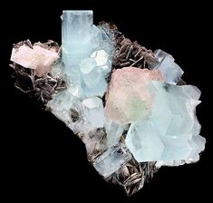 The Aquamarine crystals and large Fluorite sit atop a matrix of Muscovite and Albite! From Nagar, Hunza Valley, Gilgit District, Northern Areas of Pakistan.