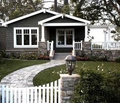 love it all - the porch, the pergola, the contrast between the house color and trim, the walkway...