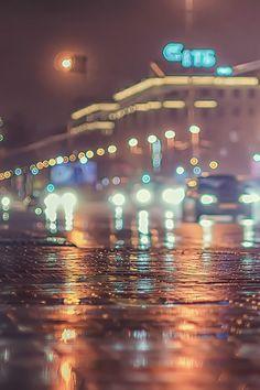 Streetlight bokeh cars rain bokeh night city lights outdoors winter street wet