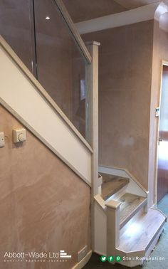 Staircase in Arlington Oak with white riser, built in lights & glass balustrade.