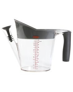 This fat separator has a large strainer to catch the drippings while stopping the chunks, a low spout to ensure you're only pouring out the flavorful juices, and a stopper that prevents fat from escaping. $14.99. #cooking #tools