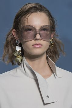 Tinted sunglasses and mismatch statement earrings from #Marni #SS17 #MFW