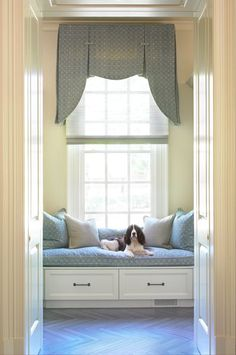 Shaped valance adorns tall window, valance with matching window seat cushion