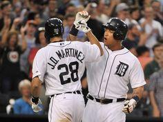 Miguel Cabrera congratulates J.D. Martinez after Martinez