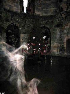 One of Britain's oldest castles. 'Ghostly' shape appears in photo of middle ages massacre site in York. The bizarre apparition, which cynics believe is a plume of cigarette smoke, appeared in a photo of the chapel in Clifford's Tower in the remains of York Castle. Hmm...looks like cigarette smoke to me, too.
