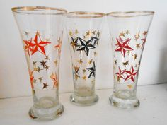 Absolutely stunning hi-ball glasses measuring 7 high. They are in lovely vintage condition, no chips or cracks, although some of the gold