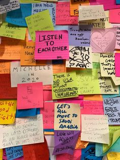 Sticky notes of solidarity cover multiple walls in NYC's Union Square subway station after the 2016 presidential election. (photo by Jillian Steinhauer/Hyperallergic)