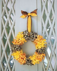 Create a festive holiday wreath out of seasonal candy.
