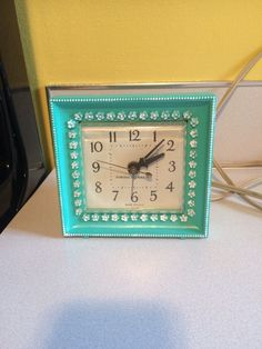 1960s GE electric alarm clock I repainted turquoise. Original finish was ivory but was very stained and worn.
