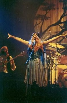 Stevie onstage  ~ ☆♥❤♥☆ ~ 'Rhiannon' with John McVie behind her as well as the iconic bare tree backdrop,  on July 19th, 1978 ~  https://en.wikipedia.org/wiki/Rhiannon_(song)