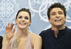 Tessa Virtue and Scott Moir of Canada wait in the results area after competing in the ice dance free dance figure skating finals at the Iceb...