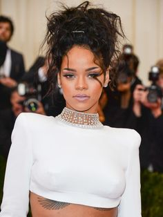 A French twist never looked so effortless. Here, Rihanna piled her curls on top of her head, leaving the ends natural.