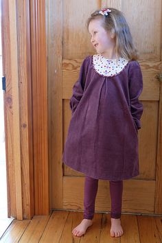 "Miss 5 and 9mths: Playdate dress with inseam pockets.Size 5 made of amethyst wide wale corduroy (Spotlight, Adelaide); yoke of cream cotton with purple and red spots, and Denise Schmidt ""Chicopee"" stripe for bias around yoke. 