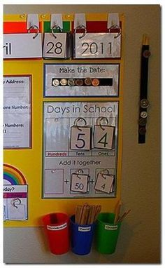 MAKE THE DATE: This is from our old calendar board. I just added a strip of velcro onto it so that we can display the date in coins. For example, on the photo to the left it is April 28th. So, there is 28 cents displayed on the board. Notice the extra coins hanging on a strip of velcro on the side. FYI, there are velcro dots on the back of the coins so that the kids can practice with real money.
