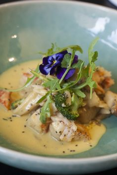 Fricassé of lobster with Thai curry, broccoli and mushrooms