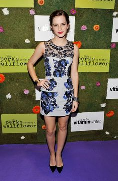 Pin for Later: 30 Stylish Reasons to Celebrate Emma Watson Emma Watson in Floral Erdem at 2012 Toronto International Film Festival The star was all smiles in an elegant yet edgy black and blue floral-embroidered Erdem mini at the 2012 Toronto International Film Festival.