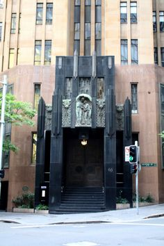 """City Mutual Life Assurance Building, Sydney, Australia  The building entrance, which features a large sculpture called """"Flight From Vesuvius."""" CMLA was an insurance company so I suppose this makes sense?"""