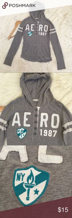 """Aeropostale Womens Small Long Sleeve Grey Hoodie • Henley  • Grey  • Kangaroo pocket  • New York badge  • Excellent condition no flaws  Length: 23.5""""  Armpit to armpit: 17"""" stretchy  📌NO lowball offers 📌NO modeling 📌NO trades  Come check out the rest of my closet! I have various brands and ALL different sizes! Aeropostale Tops Sweatshirts & Hoodies"""