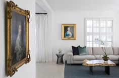 Philadelphia based designer Christina Yorkston accented this contemporary space with antique portraits displayed in ornate gilded frames.