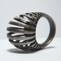 Armadillo ring 3D printed in stainless steel free by uptomuch