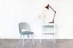 Thonet chair in grey / blue with vintage tablelamp and white cabinet + dried flowers