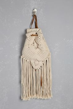 0cb8e7a7aeb6 A crochet knit backpack from Z amp L Europe amp trade  featuring suede  drawstring shoulder