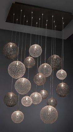 Modern chandelier...cool idea for a basement bar!