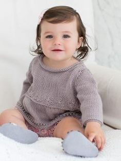 Ava - This cute girls tunic is taken from Little Rowan Cherish by Linda Whaley using Summerlite DK. It features simple lace eyelets and embroidery, and would be a suitable project for the less experienced knitter. Rowan Knitting Patterns, Baby Sweater Knitting Pattern, Baby Sweater Patterns, Tunic Pattern, Knitting For Kids, Easy Knitting, Knitting Designs, Brei Baby, Rowan Yarn