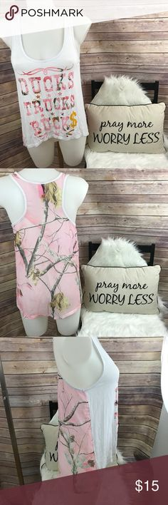 """Just Ginger Real Tree Baby Pink Tank Size S Adorable high/low style Racer Back Graphic Tank Top. Racer back part is baby pink Real Tree Camo. Camo part is sheer.   Brand: Just Ginger/Realtree  Condition: EUC. No snags, holes, rips or stains.  Length (low): 25 1/2""""  Length (high): 14 1/2""""  Width: 16 1/2""""  Measurements are approximate  96% Rayon, 4% Spandex. Contrast: 100% Polyester. Made in USA of Imported Fabrics  Thank you for shopping! Just Ginger Tops Tank Tops"""