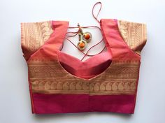 Client blouse #shortSleeves #TajmahalNeck #orange Blouse material from @vacollections saree's