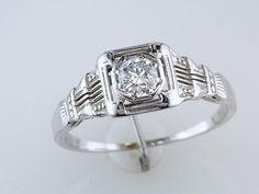 Antique Art Deco Diamond Filigree Engagement Ring in 18k White Gold, 0.20 European Cut Diamond (VS1 Clarity/ G Color). $635.00, via Etsy.