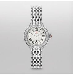 Serein 12 Diamond Watch Feminine, elegant and charmingly petite, the new Serein 12  Diamond captures the imagination with a beautifully curved, diamond-embellished case. Roman numerals and the signature MICHELE logo add the finishing touches. The stainless steel bracelet is interchangeable with any 12mm MICHELE strap.