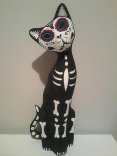 old cat statue = sugar skull kitty! been wanting to do just this.