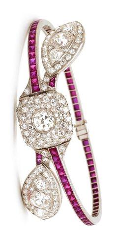 A magnificent Art Deco platinum, diamond and ruby bangle. #ArtDeco