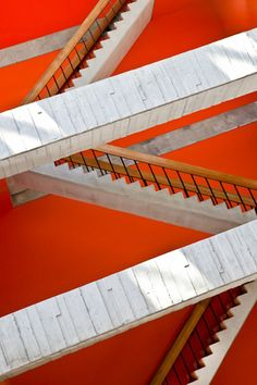 criss cross staircases. love the red contrast. http://pinterest.com/intlhomeshow/