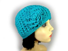 This elegant turquoise beanie hat is accented with a beautiful matching flower. It is hand crocheted with soft wool blend. It can be worn either casually or as an accompaniment to a more elegant outfit. Either way, it is lovely and soft, very comfortable to wear, and will keep your head cosy and warm. Elegant Outfit, Hand Crochet, Beanie Hats, Cosy, Wool Blend, Turquoise, Warm, Flower, How To Wear