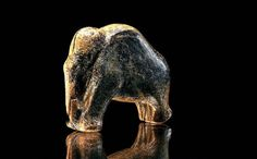 This tiny mammoth survived the last glacial. It was crafted in ivory with simple flint tools 35,000 years ago in southern Germany