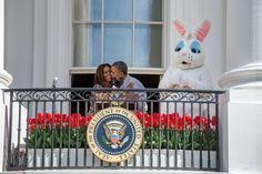 President Barack Obama kisses First Lady Michelle Obama after introducing her at the annual Easter Egg Roll on the South Lawn of the White House, April 21, 2014. The bunny looks shocked. (Official White House Photo by Chuck Kennedy)