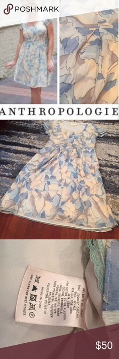 Anthropologie Moulinette Soeurs Leaf Dress Anthropologie Moulinette Soeurs Cream, Blue & Gray Leaf Print Dress. 17.5 inch bust. 14 inch waist. Pleats on front to make the skirt more of an A-line. 35 inches long. Silk Blend. Lined. Side zipper. Gently worn to a couple events. Excellent condition. Anthropologie Dresses