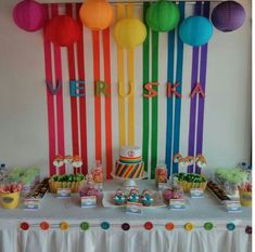 Rainbow party ideas - lanterns, streamers, table decorations