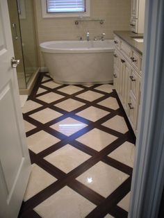 Master Bath Renovation, Bamboo flooring with 12 X 12 crema marfil marble tile, Bathrooms Design. wow that looks amazing, i wonder how it would wear, if the movement of the wood and non movement of the tile will cause buckling. -SD