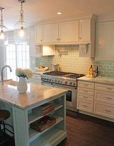 Gorgeous kitchen by Nick & Wendy Guehne of Guehne-Made, Kansas City. Island is painted Sherwin-Williams Tidewater. Featured on House of Turquoise blo