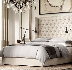 Reference only for layering style - matching duvet and shams, duvet folded back to reveal sheets, quilt layered across bottom.