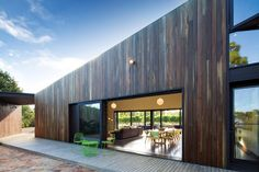 Timber cladding has the texture of wine barrels. Shoreham House, located In a vineyard on Victoria's Mornington Peninsula, is a weekender by Jackson Clements Burrows.