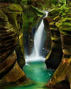 Photo Details          Title: Corkscrew Falls      State/Province/Region: Ohio        Country: United States        Nearest Area: Hocking Hills        Nearest Town: Logan  Park: Hocking Hills State Park     Season: Spring.        Description: Waterfall in a remote country location in Southern OH