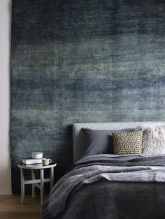 The Design Files // Winter Hibernation // ombre rug; quilted bedhead; side table; handmade ceramics; quilt; mohair; flannel sheet; charcoal; blue; ink; cashmere; missoni; american oak floor