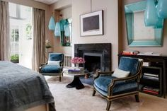 Contemporary Bedroom by Francis Sultana Ltd. and Thomas Croft Architects in London, England blue vintage Jansen chairs