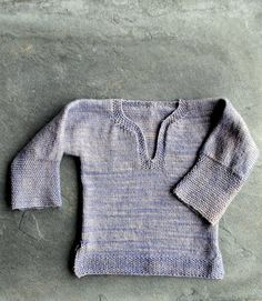 """TheEasy Baby Cardiganfrom Joelle'sMore Last-Minute Kitted Giftshas become a Purl Soho classic... but it wasn't the original! Before she knit up that worsted weight cardigan, Joelle first conceived of a lightweight, all-season pullover. At 7 stitches to the inch, it wasn't exactly a """"last minute knitted gift"""" and so it evolved; but Joelle never forgot the adorable prototype she had decided to shelve! The inspiration behind both sweaters was always Joelle's intrig..."""