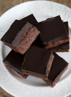 Get this tested recipe for moist and tender gluten free chocolate frosted brownies.